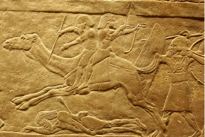 Kedarites on camels pursued by Assyrians. Panel from N. Palace of Ashurbanipal